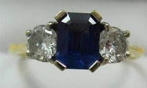 superb rectagular sapphire and diamonds three stone trilogy deco ring 18ct wow